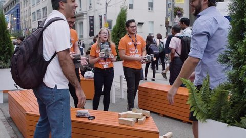 Toronto, Ontario / Canada - 09 08 2018: Strangers play jenga on the street during TIFF