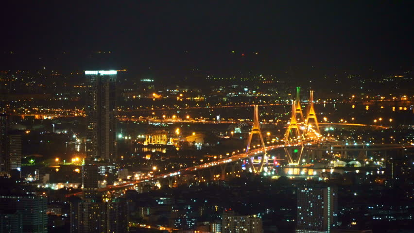 Aerial view of Bhumibol Bridge and Chao Phraya River in structure of suspension architecture concept, Urban city, Bangkok. Downtown area at night, Thailand. | Shutterstock HD Video #1021504195