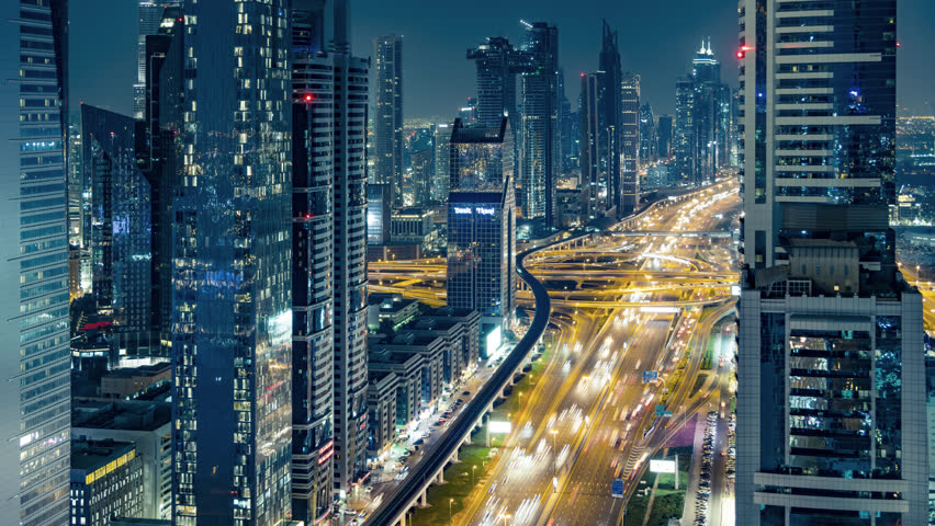 Time lapse of financial skyscrapers and street traffic at night in Dubai city center business district HQ 4K UHD HDR 444 10 bit ProRes #1021528885