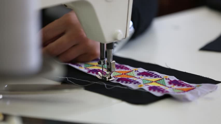 Arab woman embroidering a dress In a sewing workshop. | Shutterstock HD Video #1021538365