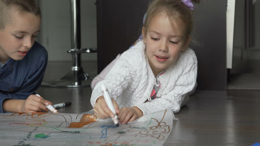 Siblings drawing and coloring on paper sheet   Shutterstock HD Video #1021549765