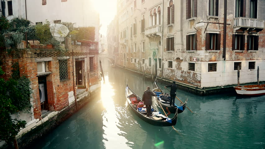 Magic drone shot of Venice with gondola in canal | Shutterstock HD Video #10215728