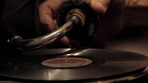 Man Putting Needle on an Old Vinyl Record.