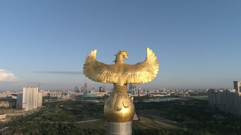 Astana, Kazakhstan - July 13, 2018: The statue of the Golden Eagle on the Independence Square of Kazakhstan