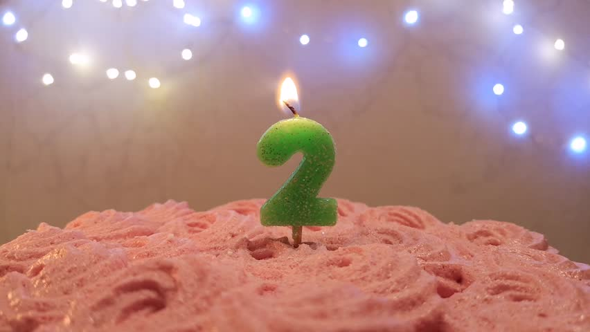 Birthday Candle On A Cake Number 2 Blow Out At The End Color Blurred Background