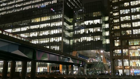 London Canary Wharf Offices Skyscrapers and Railway Trains at Night