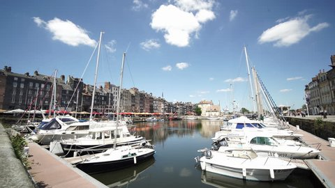 HONFLEUR, FRANCE - JUNE 2018: Timelapse video of the Honfleur harbour old port with beautiful houses and lots of yachts. Honfleur is located in the northern region of Calvados, Normandy, France.