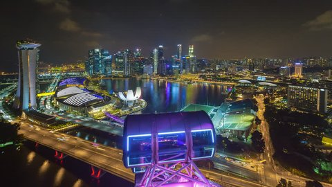 MARINA BAY, SINGAPORE - NOVEMBER 2016: Time lapse of Marina Bay Singapore city skyline aerial view with motion. Prores 1080p. Pan down motion timelapse.