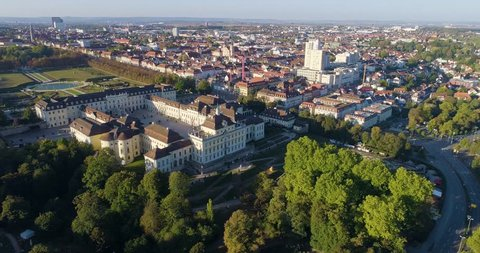 Camera slowly zooms in from north-east corner of Ludwigsburg Palace in Ludwigsburg, Germany. View of North Garden and North Wing. Aerial shot.