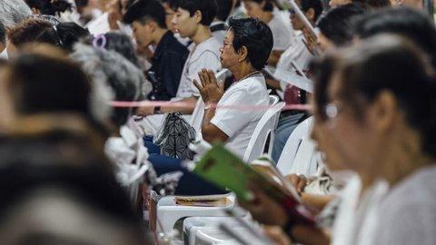 Bangkok / Thailand - December 31 2018: Thai Buddhists pray at a New Year ceremony.