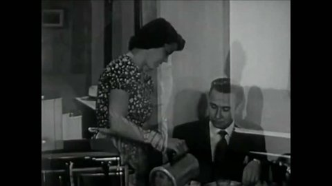 CIRCA 1950s - A newlywed woman struggles to settle into her life as a housewife in the 1950s - .