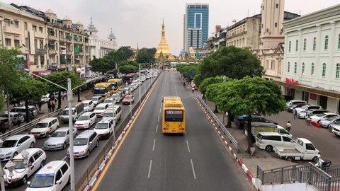 Yangon, Myanmar Dec. 20 2018 : Traffic around Sule pagoda in Yangon, Myanmar (Burma) 4K