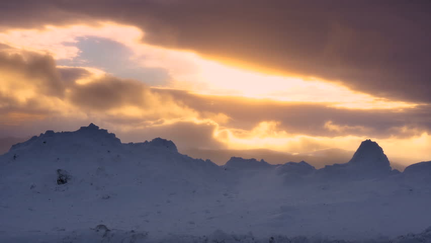 Winter blizzard in the mountains at sunset | Shutterstock HD Video #1022016235