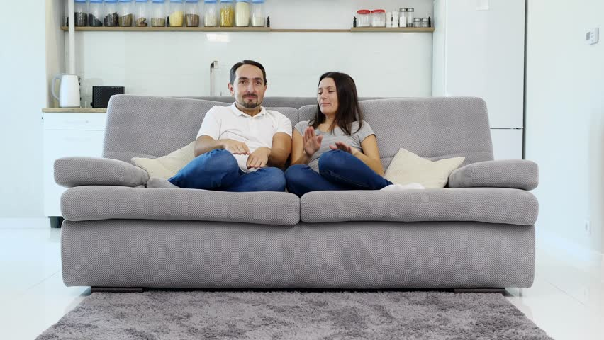The husband and wife have fun on the couch  | Shutterstock HD Video #1022025985