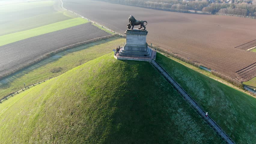 Aerial view of The Lion's Mound with farm land around.  The immense Butte Du Lion on the battlefield of Waterloo where Napoleon died. Belgium.  | Shutterstock HD Video #1022042455