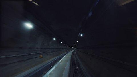 High-speed subway train running through the underground tunnel, cabin view