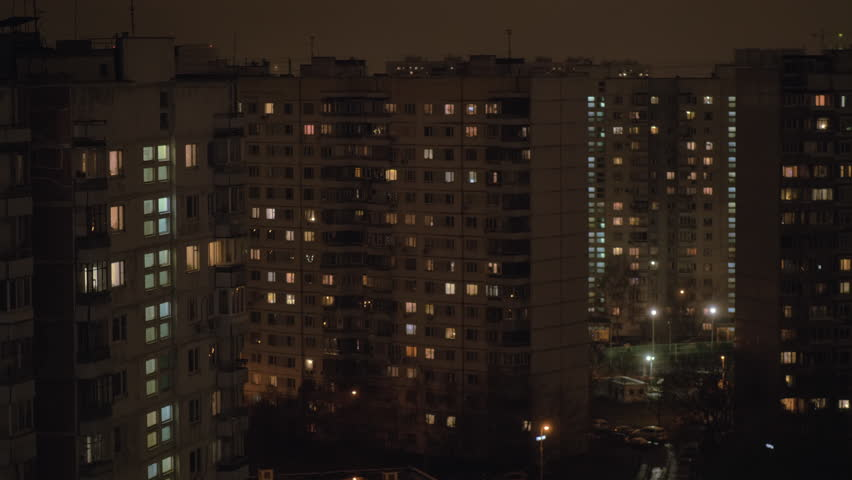 Night view of the neighbourhood with high-rise apartment blocks illuminated with window lights in the dark. Moscow. Russia #1022043715