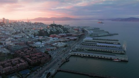 Aerial Drone Of The San Francisco City Skyline, embarcadero, pier 39 and coit tower at Sunset