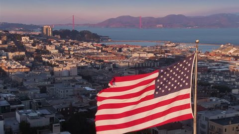 Aerial: American Flag flapping in the wind. San Francisco, USA
