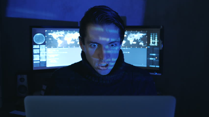 Portrait of Angry Hacker Programmer screams and shows aggression while working at the computer. Stress in the workplace. | Shutterstock HD Video #1022097355