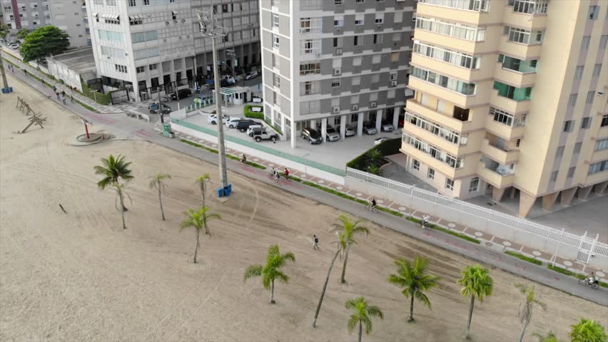 Top View Of People Cycling Along The Buildings - Moving Towards   Shutterstock HD Video #1022120425