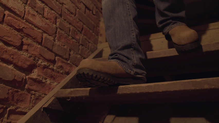 Someone going down the stairs into a basement | Shutterstock HD Video #1022143285
