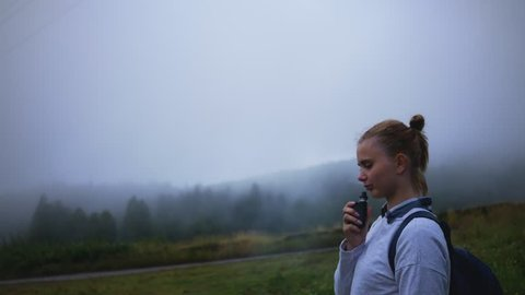 girl uses vape in a misty forest
