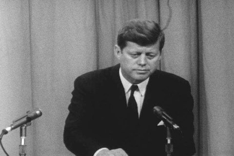 CIRCA 1961 - JFK is tight-lipped about Cuba at a news conference.