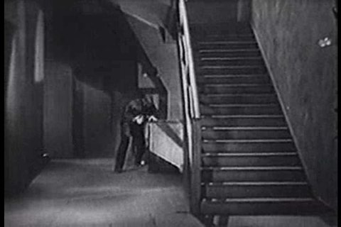 CIRCA 1940s - Two men are caught snooping around a military warehouse and get into a brawl 1940s