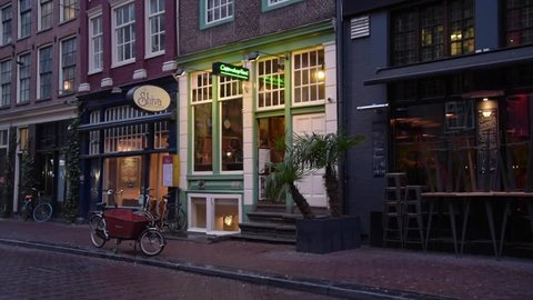 Amsterdam, The Netherlands - January 11 2019: Coffee shop in street of Amsterdam