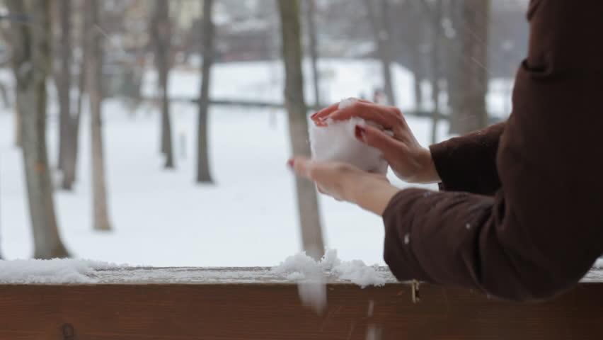 Close-up. Women's hands collect snow, make snowballs and snowmen. Winter fun. | Shutterstock HD Video #1022288635
