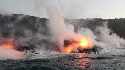 Lava ocean - flowing lava reaching ocean on Big Island, Hawaii. Lava stream seen from the water flowing from Kilauea volcano near Hawaii volcanoes national park, USA. 59.94 FPS, Steadicam.