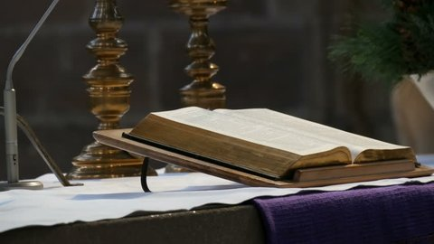 Great book of the priest lies on the altar in the old catholic church