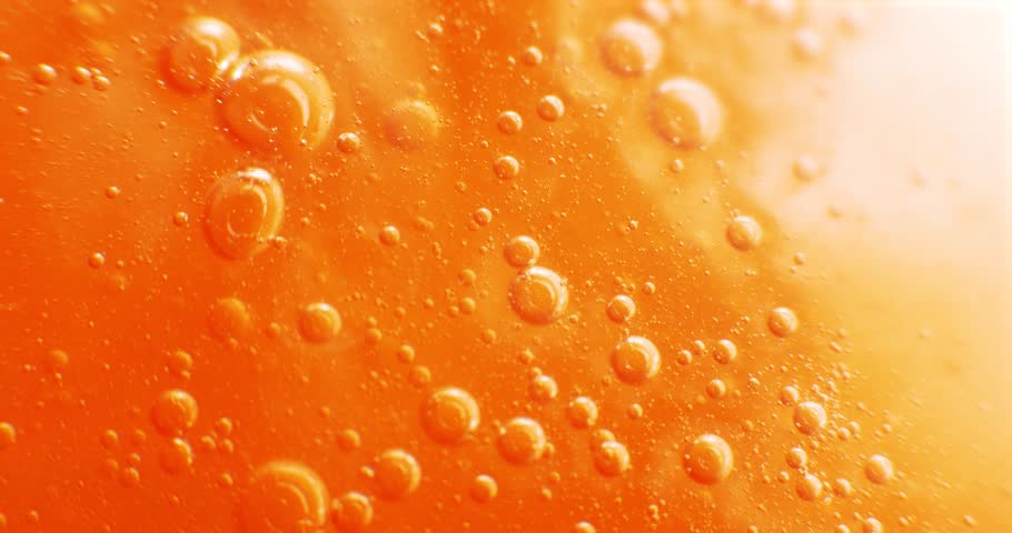 Extreme macro of bubbles in orange gel | Shutterstock HD Video #1022401765