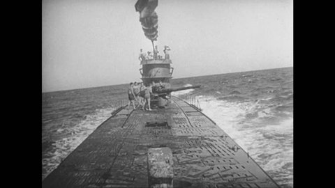 UNITED STATES 1940s: View from boat, gun fires / Explosion in water / Ship gun fires / Ship explodes / Wave hits camera, side of ship / Sailor turns valve / Torpedo launches / Ship explodes.