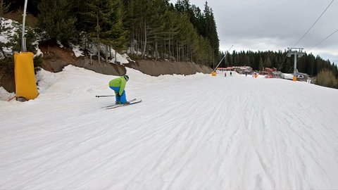 Skiing, winter, ski vacation - cinematic young man skiing down ski slope, fun on mountainside, super slow motion