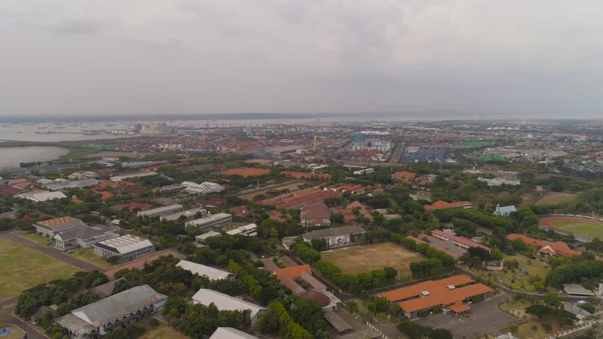 aerial view container terminal port surabaya. cargo industrial port with containers, crane. Tanjung Perak, indonesia. logistic import export and transport industry