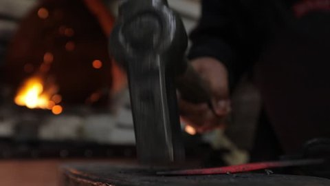 Making a knife from hot steel. Slow motion