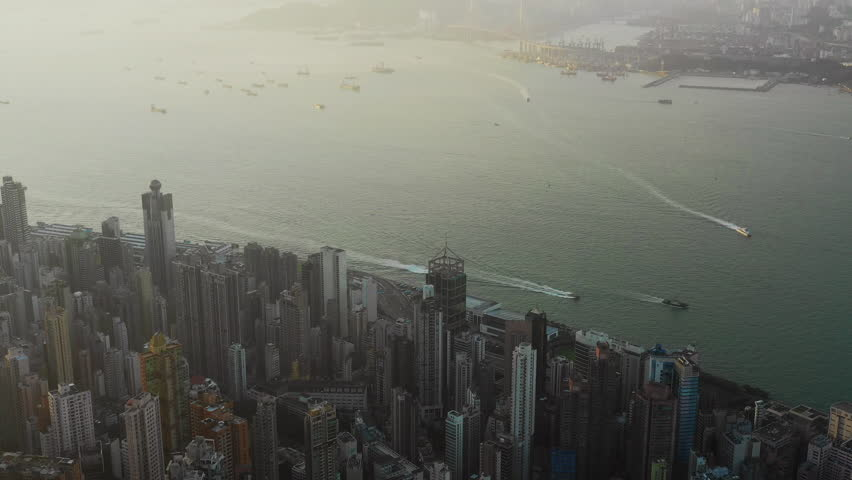 Fly over Urban city scene around Victoria peak and Victoria Harbour with Day light, Hong Kong Transportation, 4k high resolution video | Shutterstock HD Video #1022637745