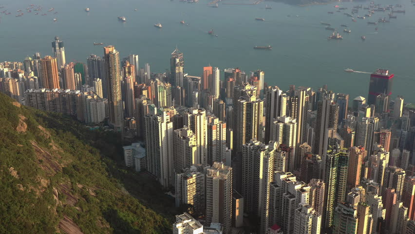 Fly over Urban city scene around Victoria peak and Victoria Harbour with Day light, Hong Kong Transportation, 4k high resolution video | Shutterstock HD Video #1022637775
