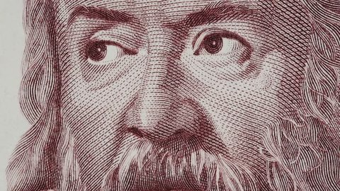Galileo Galilei on Italy banknote macro slow rotating. Genius inventor, philosopher, astronomer, mathematician. Famous scientist in physics and astronomy, discoverer of telescope. Stock video footage