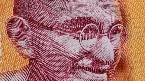 Mahatma Gandhi on India 200 rupee banknote slow rotating. Indian money currency bill. Stock video footage