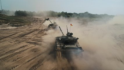 Military Army Tank Driving Aerial View. Back View Armoured Combat Fighting Vechicle Moving in Sand. War Battle Technology Concept. Drone Shot Footage 4K (UHD)
