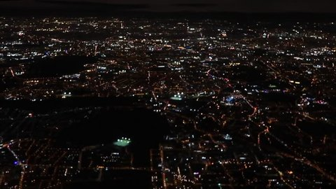 city lights at night from a plane window view