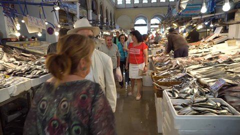 Athens,Greece May 3,2018 - Athens Fish Market.Seafood Stalls with Fishmongers and Shoppers in Central Market in Athens, Greece.