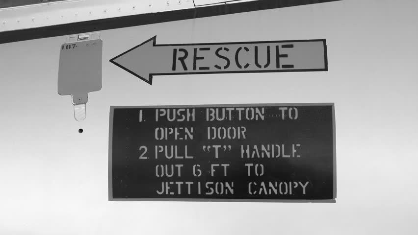 RESCUE instructions on fuselage of military fighter jet.   Black and white. Handheld shot with stabilized camera. | Shutterstock HD Video #1022843335