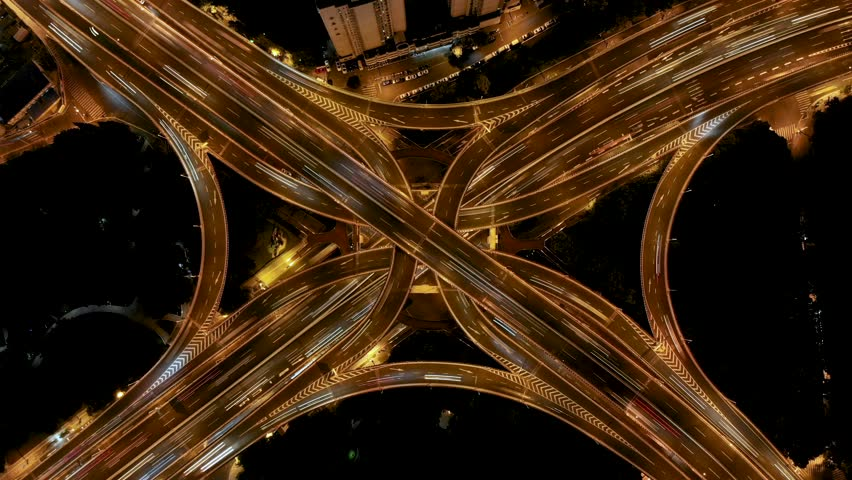 Night highway drone timelapse. Time lapse looking down at freeway interchange in downtown Shanghai, China. Modern metropolis busy roads at rush hour in downtown city center. | Shutterstock HD Video #1022857975