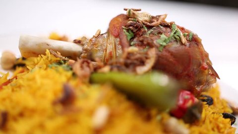 cooked rise with meat with spices  in Saudi traditional way kabsa with laham