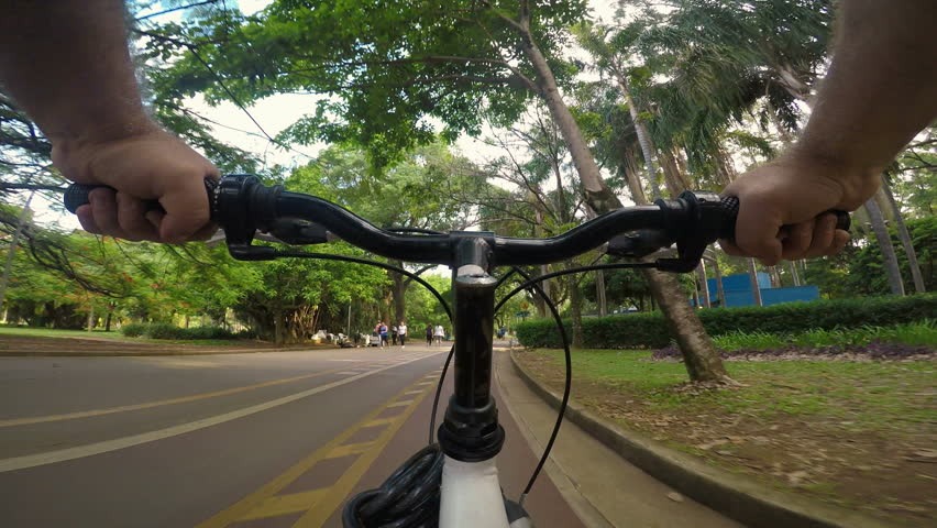 Sao Paulo, Brasil, November 30, 2018. Gopro camera POV of cyclist pedals along the cycle path of the Ibirapuera Park, south zone of Sao Paulo