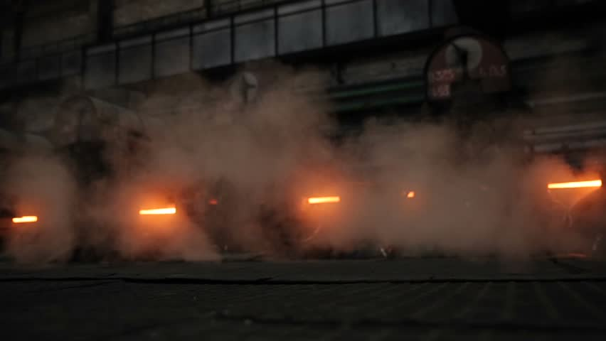 Metallurgical production. Shop. Smoke and hot steel around. Slo   Shutterstock HD Video #1023039865